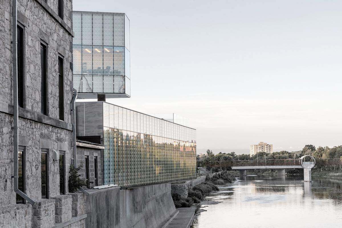 New glass volumes that are cantilevered over the adjacent Grand River / Sanjay Chauhan