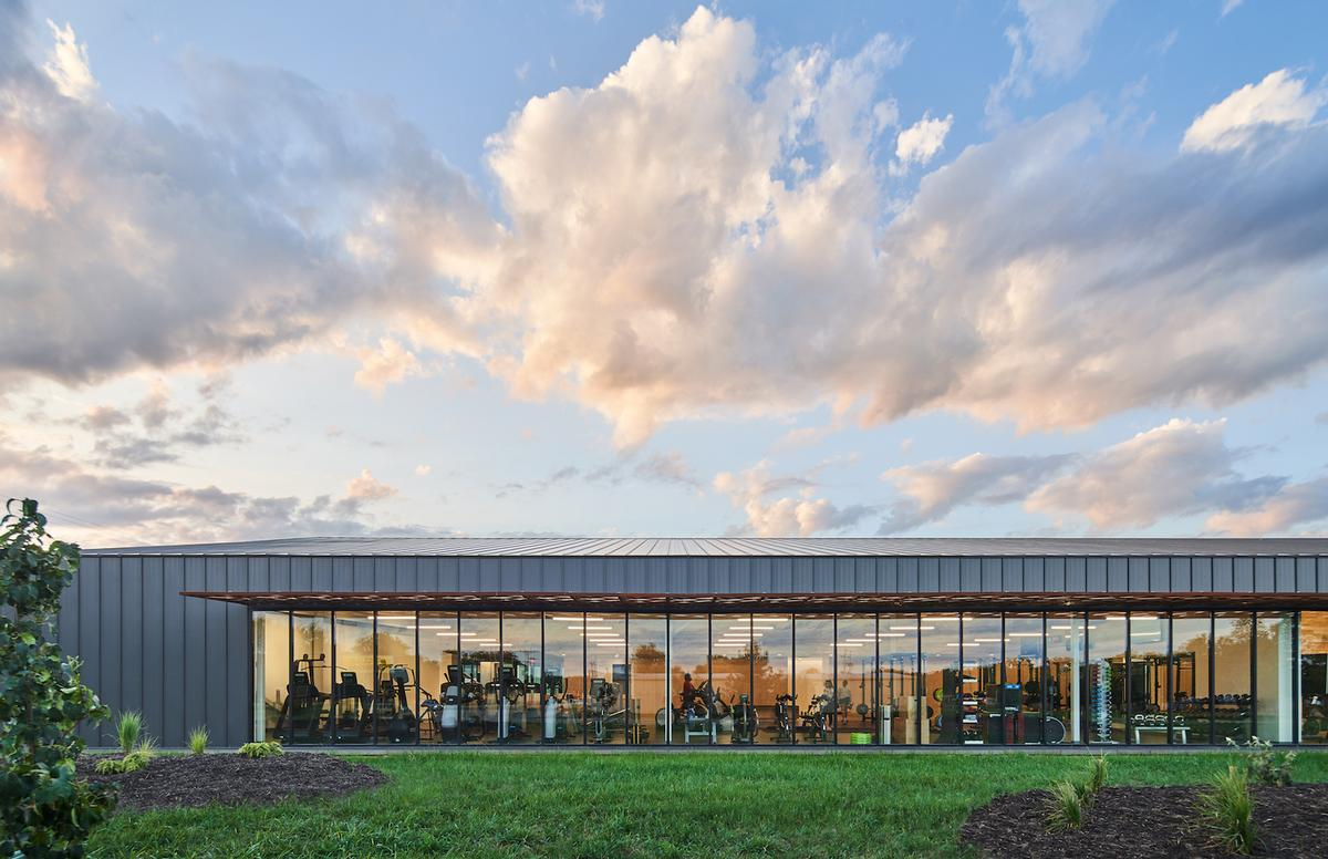 Full-height glazing along one side of the building fills the exercise spaces with natural light / Hufft
