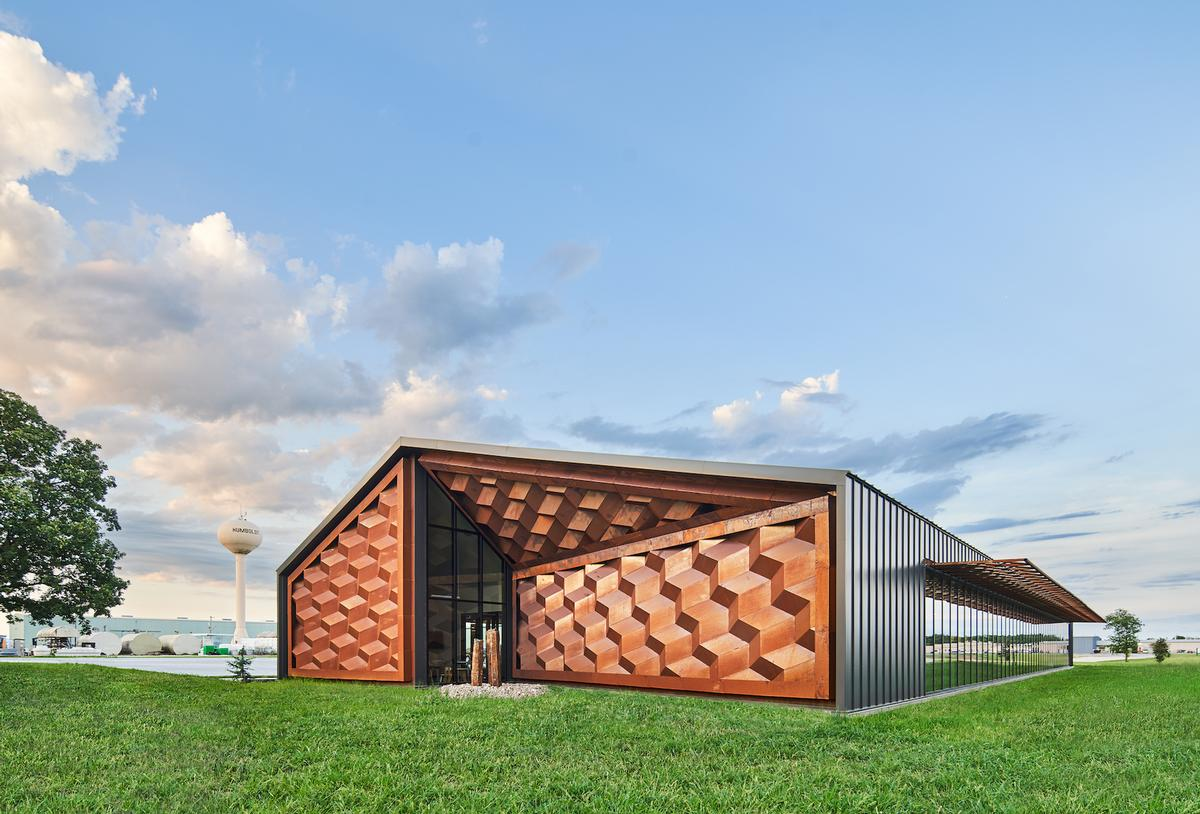The centre's form references a single-storey industrial shed / Hufft