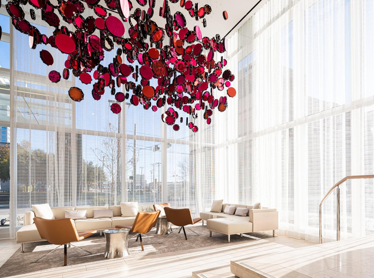 The hotel's lobby seating area is filled with natural light