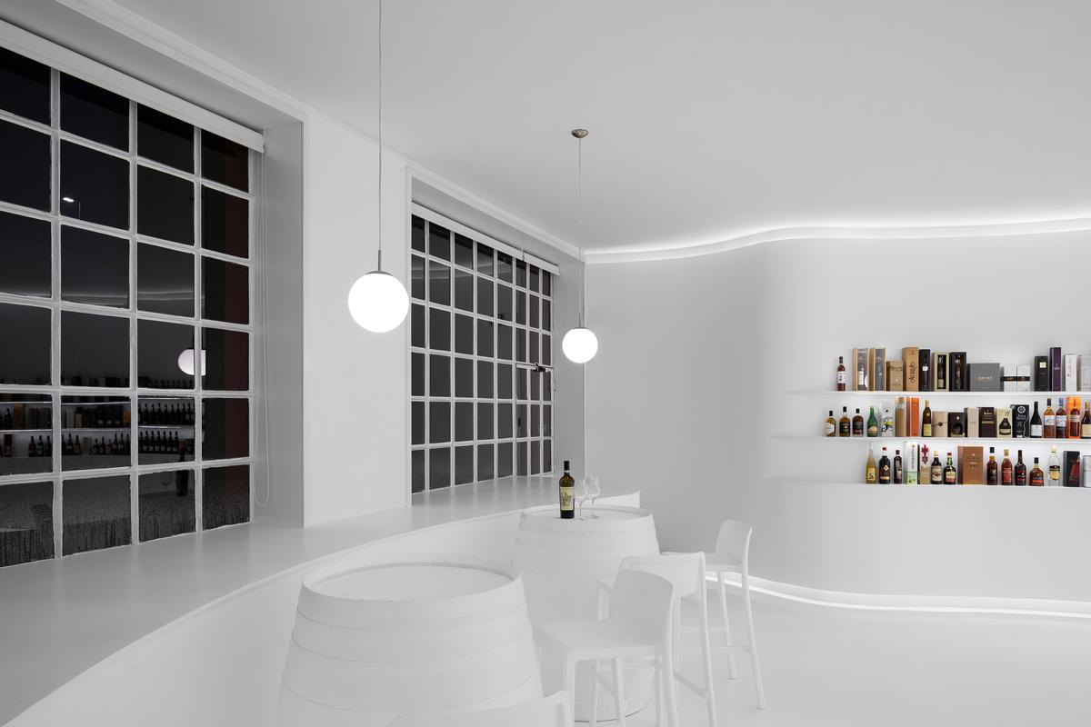 the tasting area is situated to provide views out through the windows of the space / Ivo Tavares Studio
