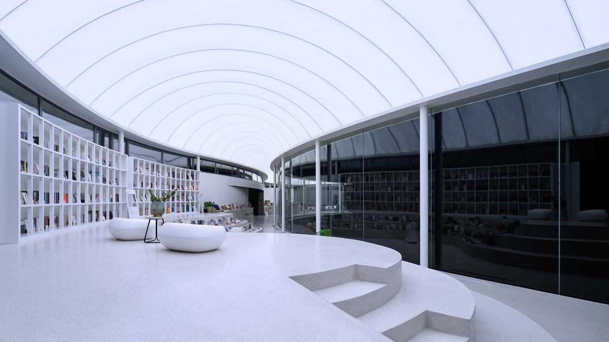 A puffed-up, arced white roof give the structure its cloud-like appearance / zystudio