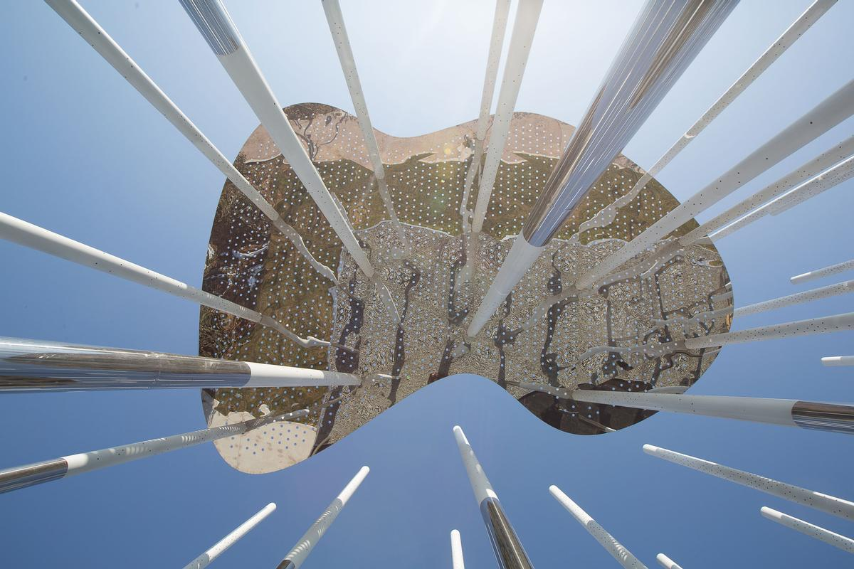 Mirrored canopies spanning multiple poles each towards the top represent clouds / Aurelien Chen