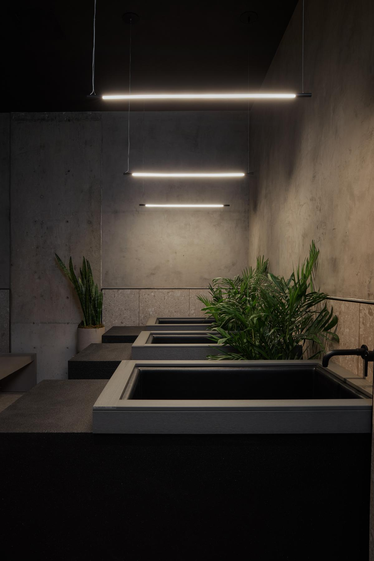 The restrooms and saunas have been designed to be refined yet austere to provide clients with clarity of mind and body