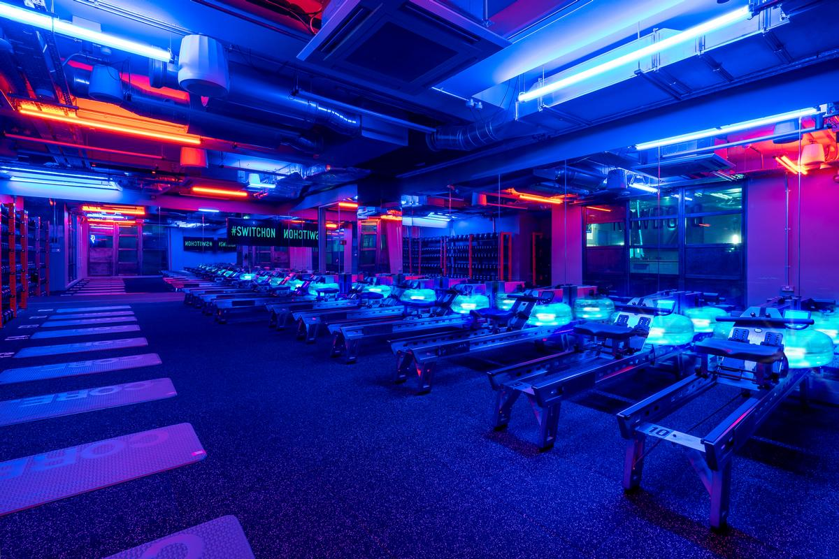 Nulty created a bold lighting design for Rowbots gym defined by contrasting tones of blue and amber in the underground space / Sarah Mannerings Studio