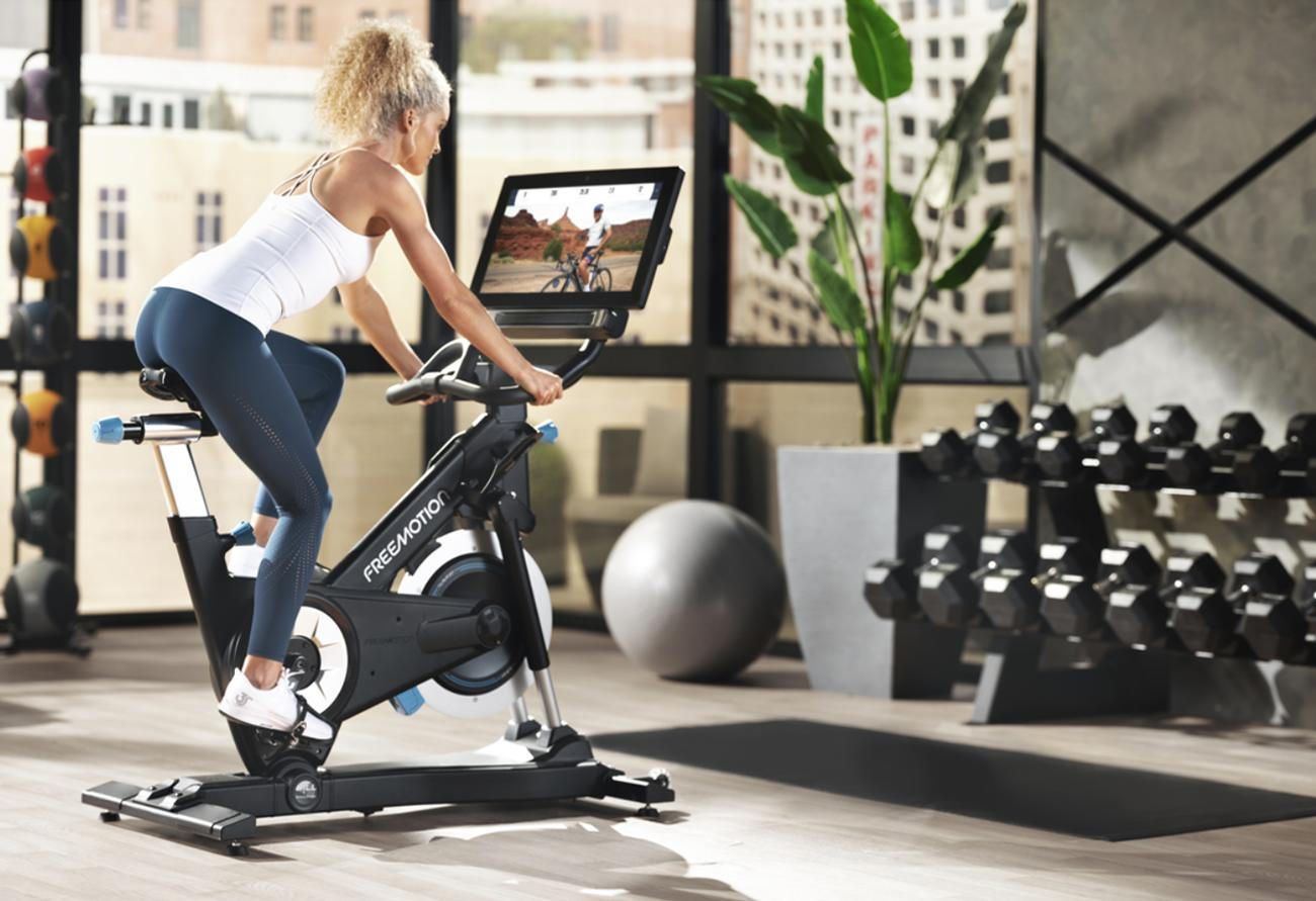 A key feature of the CoachBike is its terrain-matching technology, which auto-adjusts the speed, incline, and resistance in sync with the chosen route / Freemotion
