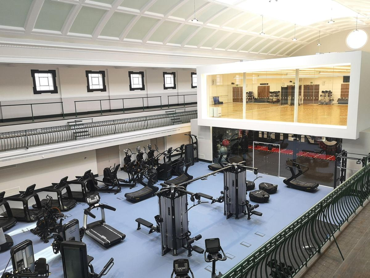 A secondary pool has been transformed into a fully equipped gym space / Fusion Lifestyle