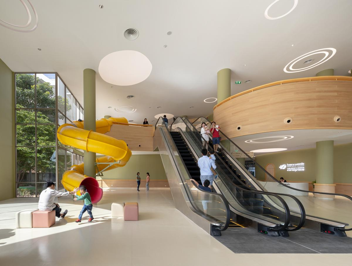 There is a giant slide at the front of the building in the entrance hall / Ketsiree Wongwan
