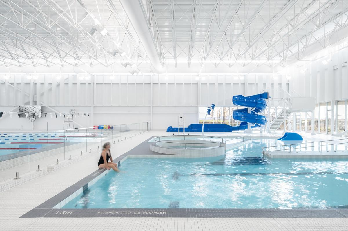 The facility houses a semi-Olympic size pool, a recreational pool and a children's wading pool / David Boyer