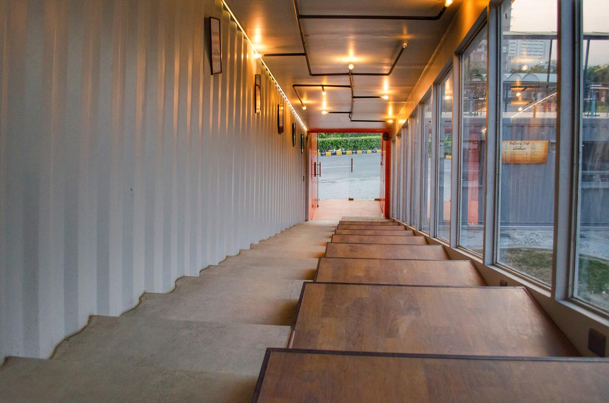 Terrace seating has been built into the stairs of the café / Rahul Jain