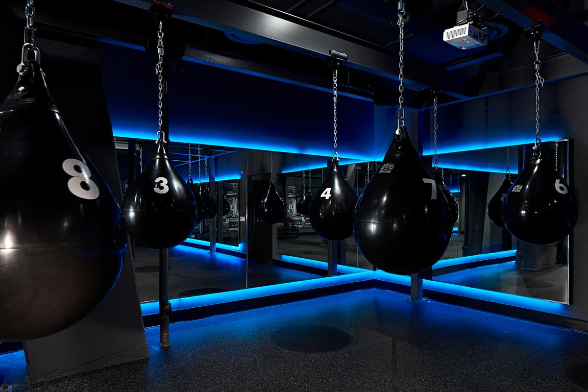 Nightclub-like lighting and music in the studio are intended to foster a motivational atmosphere for training classes / Clarence Butts