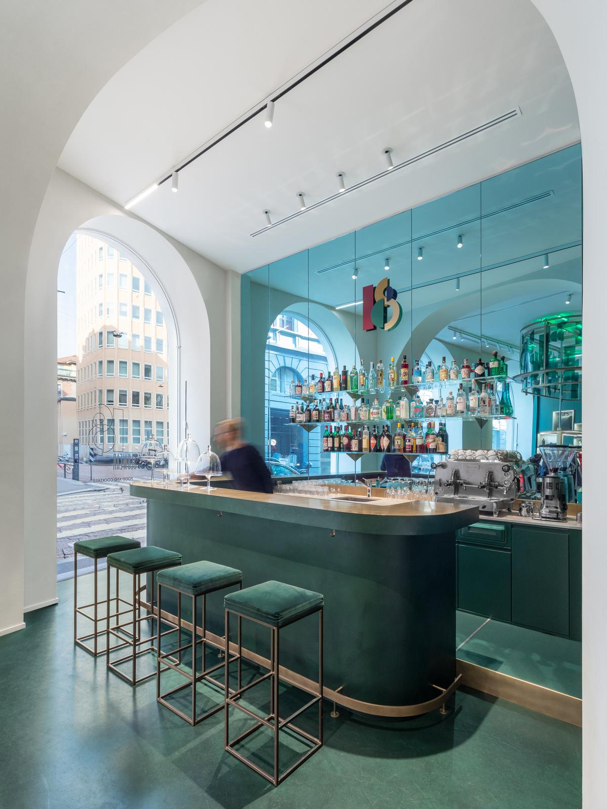 There is a wall of turquoise mirrors behind the bar / Alessandro Saletta for DSL Studio