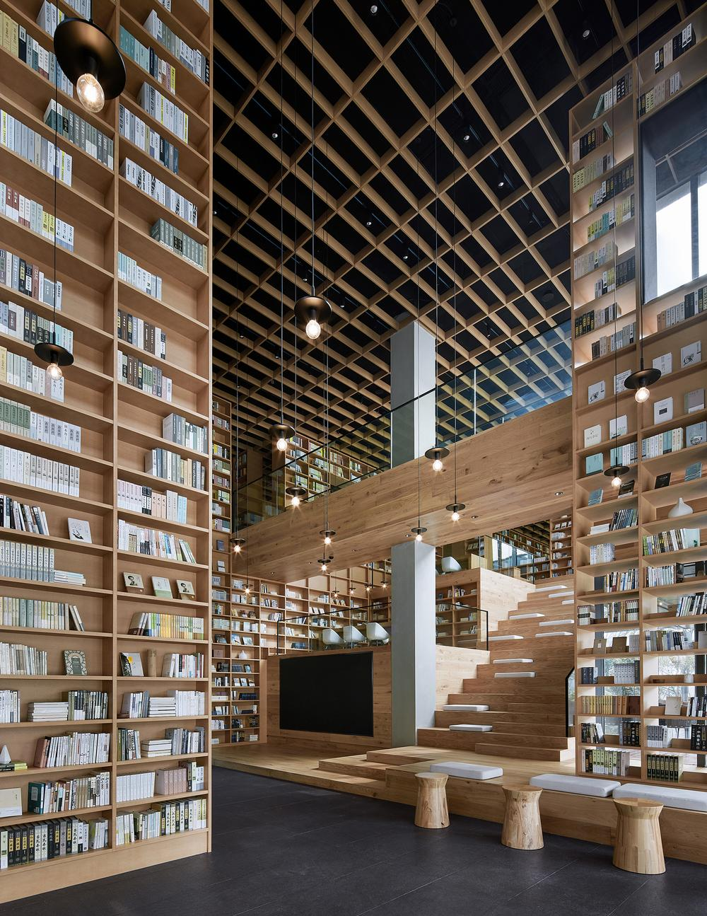 The bookshelves stretch up to 10m-high, effectively acting as walls within the larger space