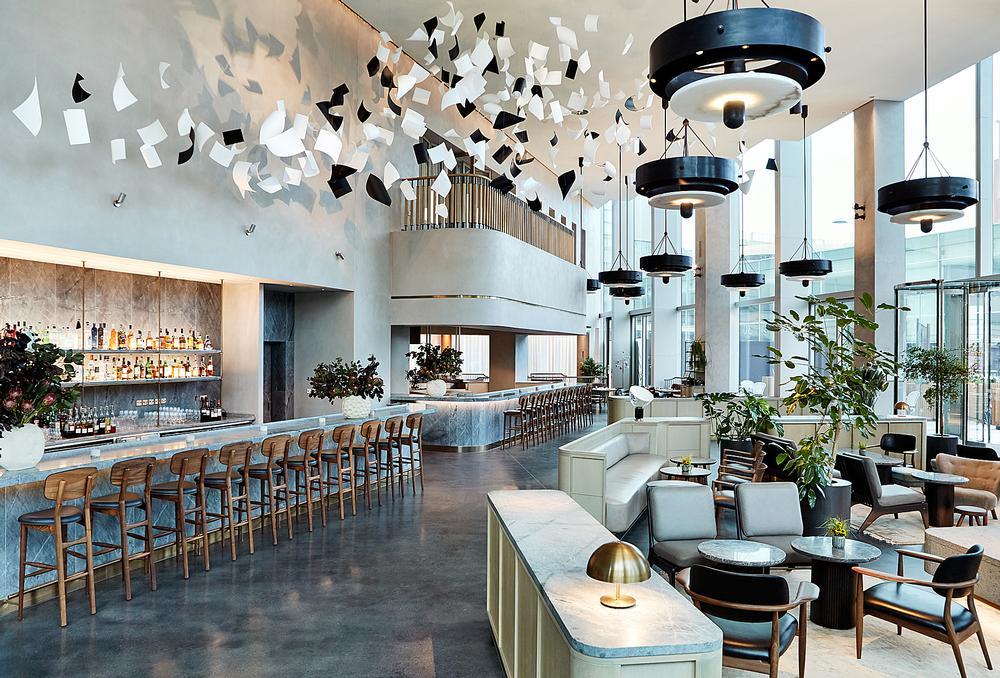 The triple height entry lobby features a brasserie restaurant / Photo: Sam A Harris