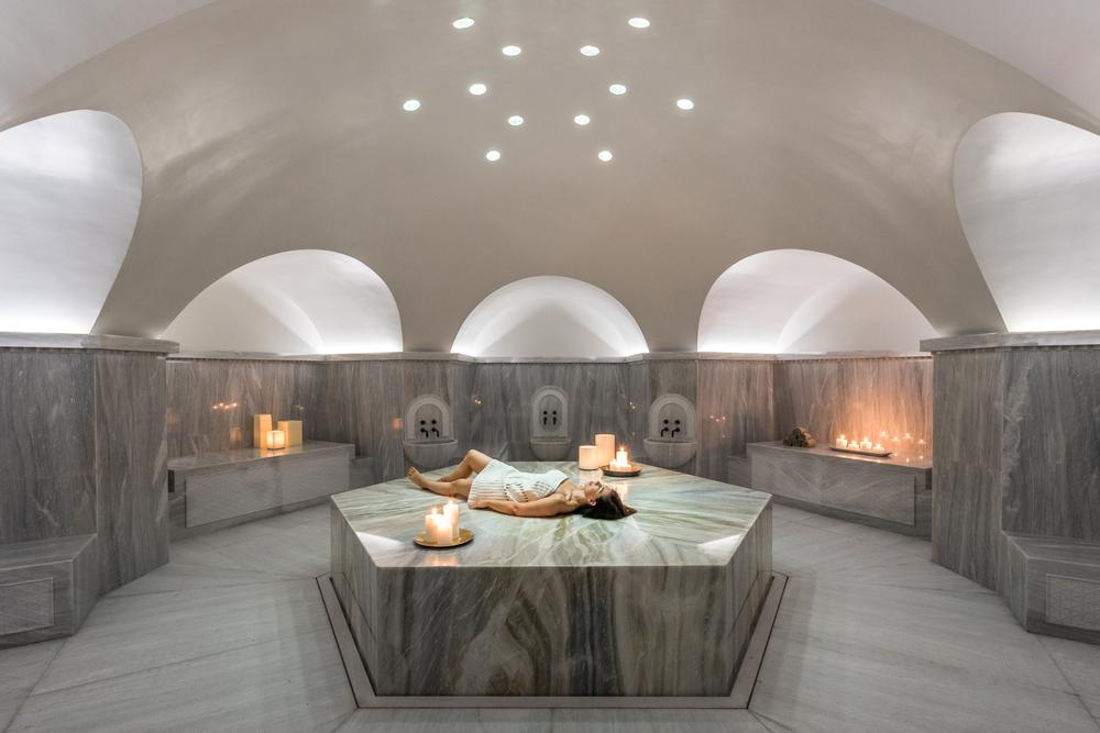 The interiors feature luxurious materials such as Greek marble, along with cool zen-like colours