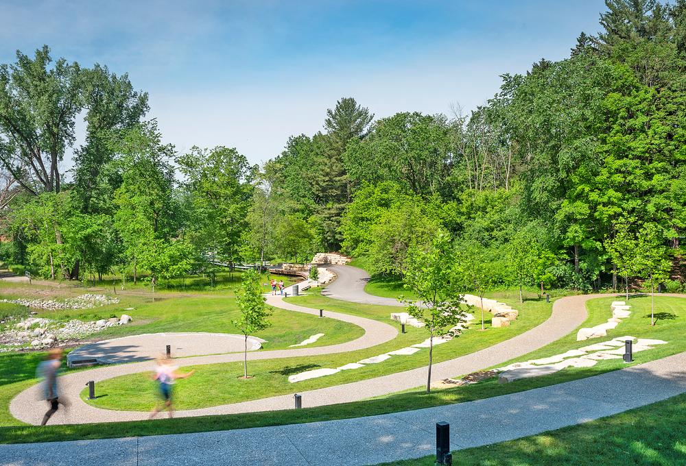 Winding pathways lead visitors through the site, connecting Whiting Forest with Dow Gardens