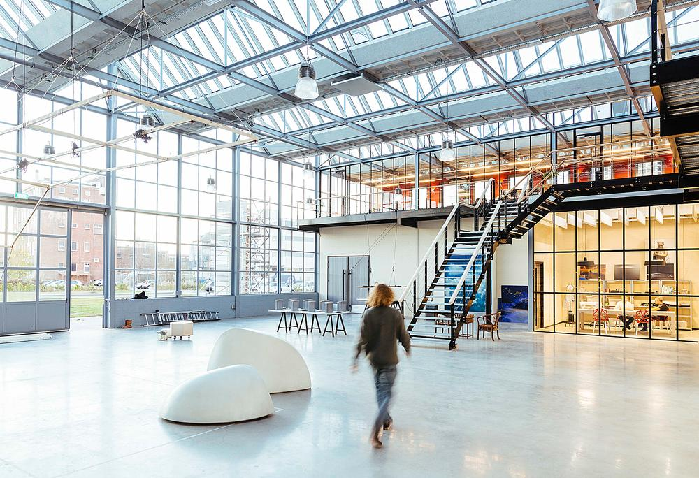 The 'Dream Factory' studio is located in a former glass factory in Rotterdam's harbour