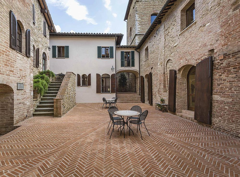 Solomeo's medieval squares and roads have been repaved and restored, with a range  of new amenties added