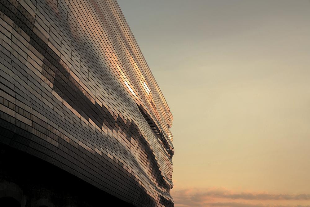 The museum's glass façade was designed to evoke a pleated Roman toga