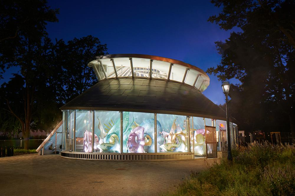 The Sea Glass Carousel in Battery Park, Manhattan, elevates the traditional carousel into a digitally-enhanced aquatic journey