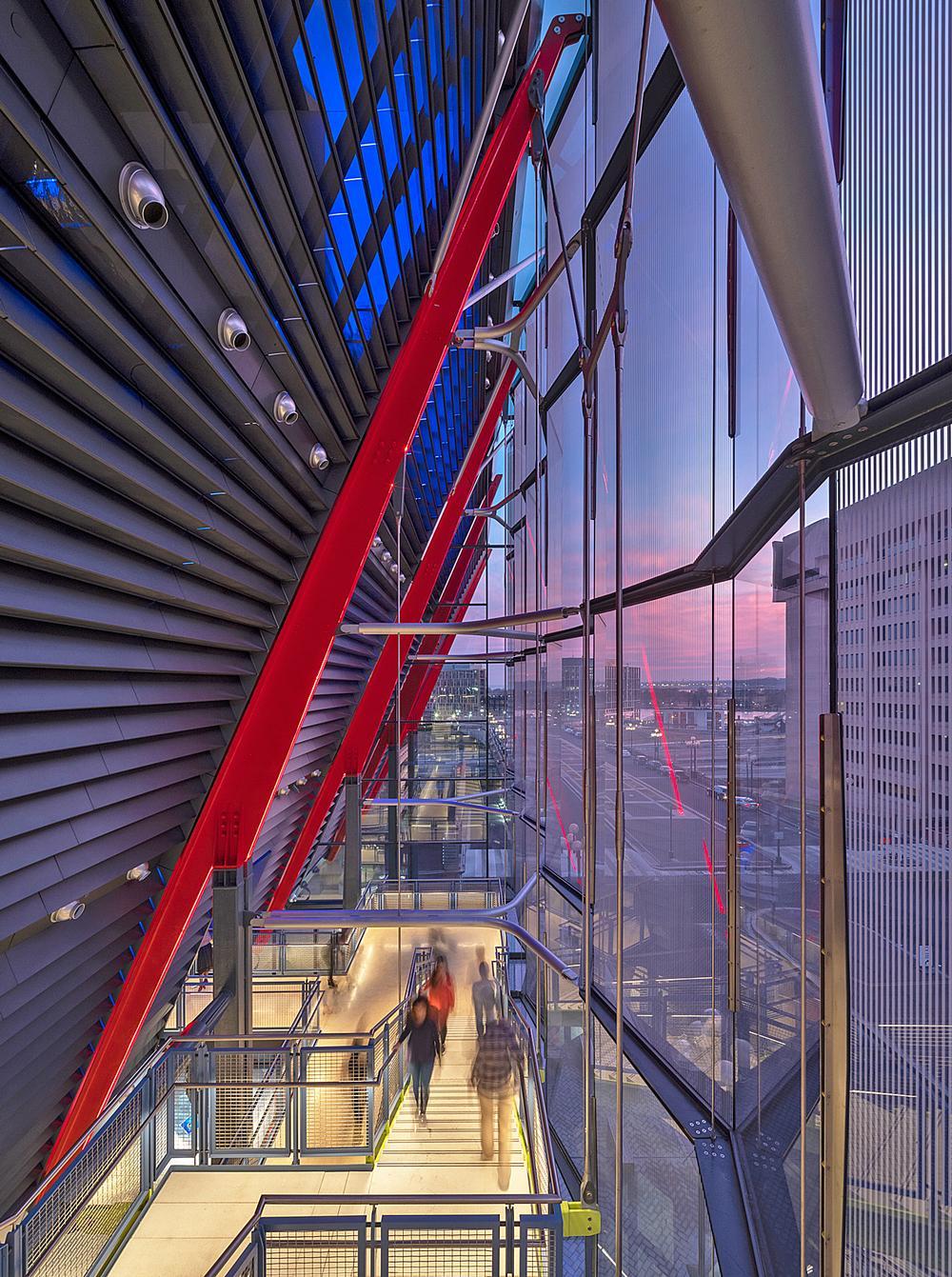 The museum's glass veil encloses an atrium and ground floor lobby / Photo: ©Nic Lehoux