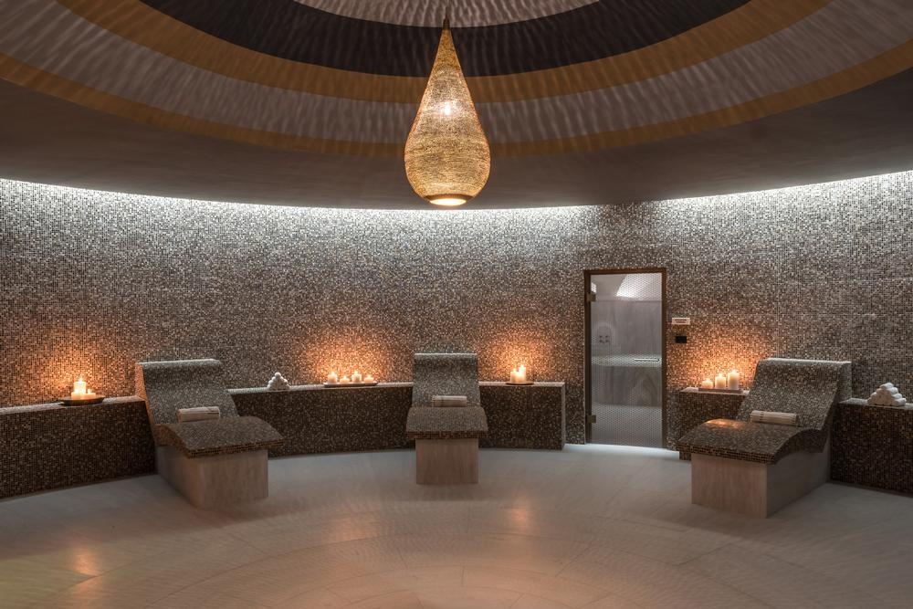 The interiors of the Euphoria Retreat include many vaulted ceilings and arches, reflecting the design of local churches
