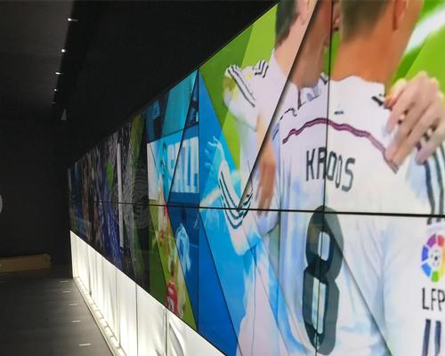 The video walls serve as a spectacular focal point at the entrance of the experience