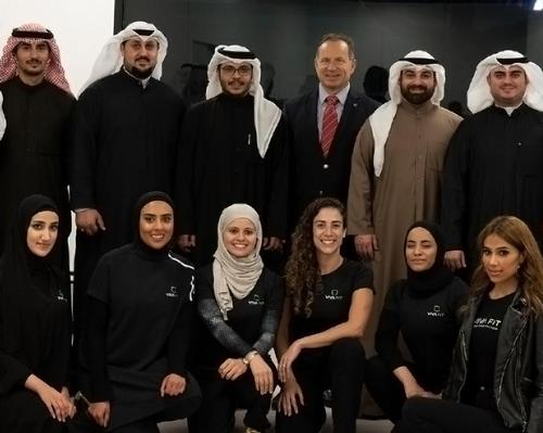 Vivafit CEO Pedro Ruiz (top line, third from right) with the master franchisee team and Vivafit Kuwait fitness staff at the opening of the club / Vivafit