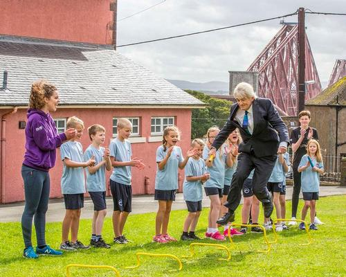 Sportscotland chair Mel Young (jumping) taking part in an Active Schools session / Sportscotland