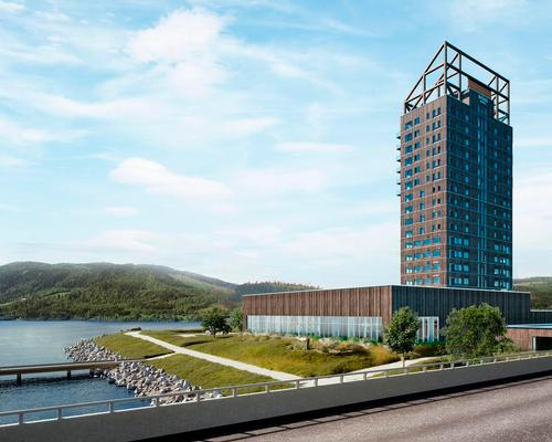 The 18-storey high-rise is located on the shore of Norway's largest lake. / Courtesy of Voll Arkitekter
