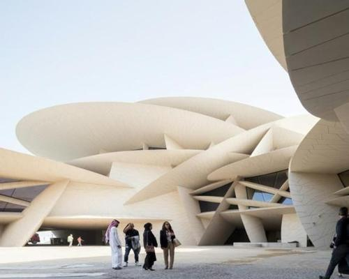 The museum, which has been likened to a utopia, is built in the shape of a desert rose. / Image by Iwan Baan