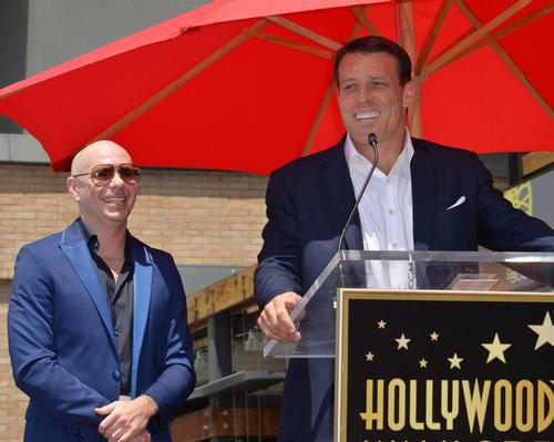 Tony Robbins teams up with rapper Pitbull to launch new boxing fitness brand