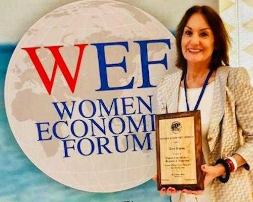Healing Hotels' Anne Biging receives 'Woman of the Decade' award from Women's Economic Forum