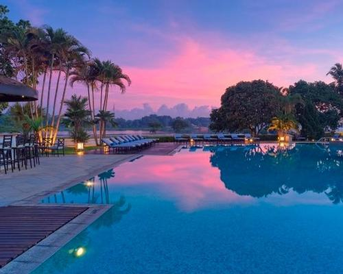 The Perfume River lies beyond the hotel's salt water swimming pool