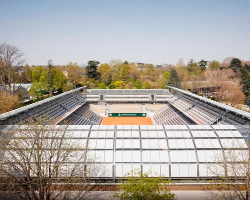 The stadium is situated amidst the 120-year-old Serres d'Auteuil botanical gardens.