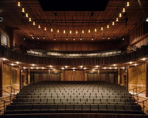 Neville Holt Opera: Witherford Watson Mann Architects have created the theatre in board marked concrete, held away from the stable block walls by a compacted hoggin edge / Hélène Binet
