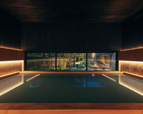 The indoor hot thermal pool are lined with aromatic wood and has large picture windows / Hoshinoya
