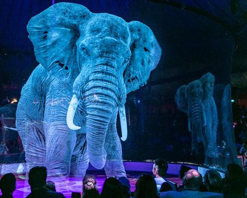 Holographic elephants perform a number of stunts in the show