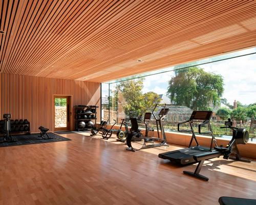 Workouts are with a view through one of world's largest glass panels in Invisible Studio-designed gym