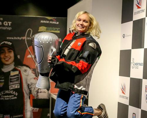 Lifting the trophy is just one of 20 interactive features at the new Silverstone Experience / The Silverstone Experience
