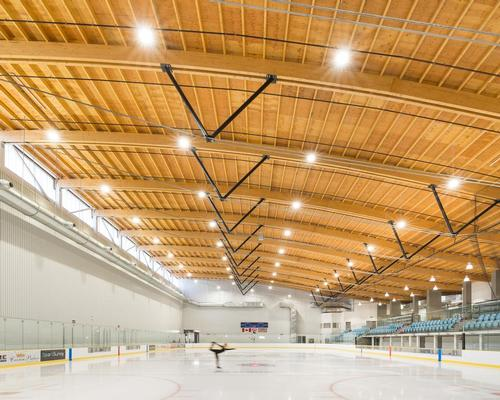 Francl Architecture ice sports centre features vast wave-like timber roof