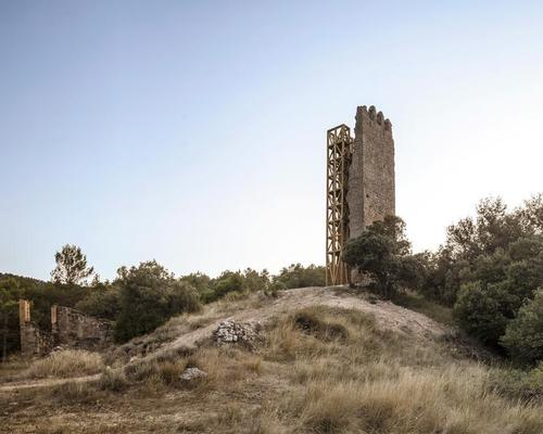 Carles Enrich Studio's timber scaffolding reactivates 13th-century lookout tower