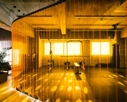 Arii Irie Architects' PVC partition is a feature and a function in tiny Tokyo gym
